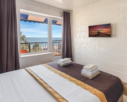 Room in the hotel Grand More with a sea view from the window